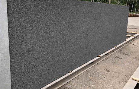 Antraciet afwerking grind betonwand